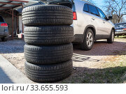 Used wheels with summer tires for suv car stacking on earth, seasonal tyre change. Стоковое фото, фотограф Кекяляйнен Андрей / Фотобанк Лори