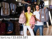 Купить «Man and woman choosing backpack together», фото № 33659581, снято 7 октября 2019 г. (c) Яков Филимонов / Фотобанк Лори