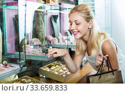 Купить «Portrait of young woman standing next to glass showcases», фото № 33659833, снято 6 августа 2020 г. (c) Яков Филимонов / Фотобанк Лори