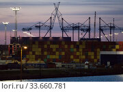 Germany, Bremerhaven - EUROGATE Container Terminal Bremerhaven, hub for the transport of goods globally and within Europe. Редакционное фото, агентство Caro Photoagency / Фотобанк Лори