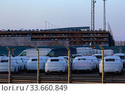 Germany, Bremerhaven - New cars at the overseas port wait on the premises of a forwarding agency for further transport. Редакционное фото, агентство Caro Photoagency / Фотобанк Лори