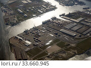 Amsterdam, Netherlands, Industry at the North Sea Canal. Редакционное фото, агентство Caro Photoagency / Фотобанк Лори
