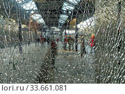Berlin, Germany, cracked glass panel in an elevator at the Messe Sued S-Bahn station. Редакционное фото, агентство Caro Photoagency / Фотобанк Лори