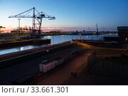 Germany, Bremerhaven - turning basin in the overseas port, rotors for wind turbines, left Container Terminal Bremerhaven. Редакционное фото, агентство Caro Photoagency / Фотобанк Лори