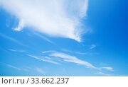 Blue sky with windy cirrus clouds at daytime. Стоковое фото, фотограф EugeneSergeev / Фотобанк Лори