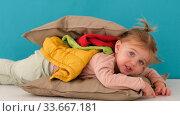 Купить «Cute girl in layers of blankets and pillows», видеоролик № 33667181, снято 26 апреля 2020 г. (c) Ekaterina Demidova / Фотобанк Лори