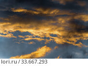 Beautiful view natural meteorology abstract background. Fluffy clouds illuminated by disappearing rays at sunset, thunderclouds floating across sky. Стоковое фото, фотограф А. А. Пирагис / Фотобанк Лори