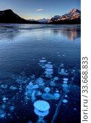Купить «Abraham Lake Winter Ice formations bubbles design», фото № 33668833, снято 4 июня 2020 г. (c) age Fotostock / Фотобанк Лори