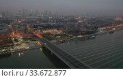 Купить «Aerial view of illuminated cityscape of Warsaw at spring twilight, Poland», видеоролик № 33672877, снято 6 июля 2020 г. (c) Яков Филимонов / Фотобанк Лори