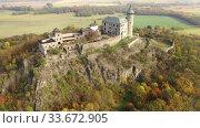 Купить «Aerial view of Kuneticka Hora Castle in autumn, Czech Republic», видеоролик № 33672905, снято 18 октября 2019 г. (c) Яков Филимонов / Фотобанк Лори