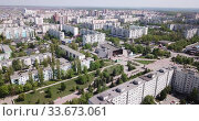 Купить «Panoramic view from drone of the residential district of city Old Oskol. Russia», видеоролик № 33673061, снято 4 мая 2019 г. (c) Яков Филимонов / Фотобанк Лори