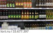 Купить «Variety of bottles of oil for sale on display in grocery shop», видеоролик № 33677397, снято 7 ноября 2019 г. (c) Яков Филимонов / Фотобанк Лори
