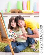 Купить «Young couple enjoying painting at home», фото № 33678009, снято 11 июля 2018 г. (c) Elnur / Фотобанк Лори