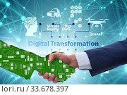 Digital transformation concept with handshake. Стоковое фото, фотограф Elnur / Фотобанк Лори
