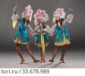 Купить «Showgirls in Russian folk dresses shot», фото № 33678989, снято 12 апреля 2020 г. (c) Гурьянов Андрей / Фотобанк Лори