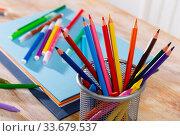 Colored pencils kept in pencil holder. Стоковое фото, фотограф Яков Филимонов / Фотобанк Лори