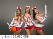 Купить «Showgirls in sexy medicine costumes shot», фото № 33680089, снято 12 апреля 2020 г. (c) Гурьянов Андрей / Фотобанк Лори
