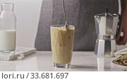 Mixing freshly preparing ice homemade cocktail with coffee and milk. Стоковое видео, видеограф Ярослав Данильченко / Фотобанк Лори