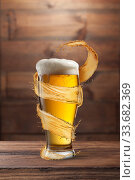 Купить «Glass of light fresh beer with flying spiral splash around mug.», фото № 33682369, снято 16 января 2015 г. (c) Ярослав Данильченко / Фотобанк Лори