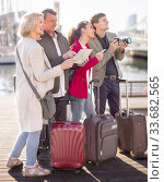 Купить «tourists with suitcases and camera walk along the pavement in port of European city», фото № 33682565, снято 10 апреля 2016 г. (c) Татьяна Яцевич / Фотобанк Лори