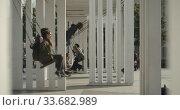 Joyful people ride on a swing in the square. Редакционное видео, видеограф Aleksandr Lutcenko / Фотобанк Лори