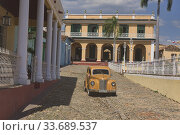 Купить «Vintage car in UNESCO World Heritage Trinidad, Cuba.», фото № 33689537, снято 18 марта 2020 г. (c) age Fotostock / Фотобанк Лори