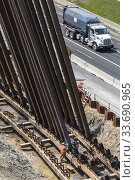 Купить «Detroit, Michigan - Steel piles are driven into the ground to support a bridge being replaced over Interstate 94.», фото № 33690965, снято 27 апреля 2020 г. (c) age Fotostock / Фотобанк Лори