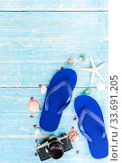 Купить «Blue Summer background with camera starfish sandle on blue wooden table background with copy space», фото № 33691205, снято 3 июля 2020 г. (c) easy Fotostock / Фотобанк Лори