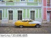 Купить «Vintage Chevy in UNESCO World Heritage Trinidad, Cuba.», фото № 33696605, снято 19 марта 2020 г. (c) age Fotostock / Фотобанк Лори