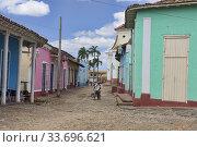 Купить «Bicyclist in UNESCO World Heritage Trinidad, Cuba.», фото № 33696621, снято 19 марта 2020 г. (c) age Fotostock / Фотобанк Лори