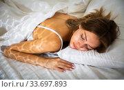 Pretty girl sleeping deeply in bed in morning. Стоковое фото, фотограф Яков Филимонов / Фотобанк Лори