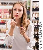 Female customer testing lip gloss. Стоковое фото, фотограф Яков Филимонов / Фотобанк Лори