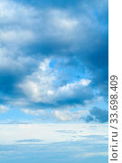 Купить «Dramatic blue sky background. Picturesque colorful clouds lit by sunlight. Vast sky landscape panoramic scene», фото № 33698409, снято 14 июля 2019 г. (c) Зезелина Марина / Фотобанк Лори