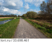 Купить «Nature trail and cycle track beside water channel, Shapwick Heath National Nature Reserve, part of the Avalon Marshes, Somerset Levels and Moors, England, UK, April 2019», фото № 33698461, снято 29 мая 2020 г. (c) Nature Picture Library / Фотобанк Лори
