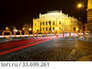 Coronavirus in Prague, Czech Republic. The building of Rudolfiunum concert halls on Jan Palach Square. Quarantine sign on a blurred background. Concept of COVID pandemic and travel in Europe. (2019 год). Стоковое фото, фотограф Владимир Журавлев / Фотобанк Лори