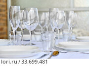 Купить «Table settings with diverse glassware and tableware close up», фото № 33699481, снято 12 марта 2020 г. (c) Alexander Tihonovs / Фотобанк Лори