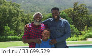 Купить «African American man spending time with his father and his son», видеоролик № 33699529, снято 19 февраля 2020 г. (c) Wavebreak Media / Фотобанк Лори