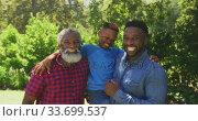 Купить «African American man spending time with his father and his son», видеоролик № 33699537, снято 19 февраля 2020 г. (c) Wavebreak Media / Фотобанк Лори