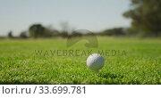 Golf player preparing to tee off  the ball with his club. Стоковое видео, агентство Wavebreak Media / Фотобанк Лори