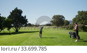 Купить «Caucasian male golfers standing on a golf course on a sunny day», видеоролик № 33699785, снято 4 ноября 2019 г. (c) Wavebreak Media / Фотобанк Лори
