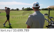 Caucasian male golfers playing on a golf course on a sunny day. Стоковое видео, агентство Wavebreak Media / Фотобанк Лори