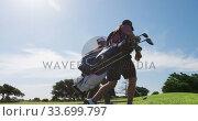 Купить «Caucasian male golfers standing on a golf course on a sunny day», видеоролик № 33699797, снято 4 ноября 2019 г. (c) Wavebreak Media / Фотобанк Лори