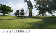 Купить «Golf player hitting the ball with his club», видеоролик № 33699809, снято 4 ноября 2019 г. (c) Wavebreak Media / Фотобанк Лори
