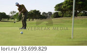 Купить «Golf player hitting the ball with his club», видеоролик № 33699829, снято 4 ноября 2019 г. (c) Wavebreak Media / Фотобанк Лори