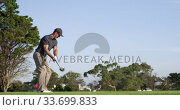 Купить «Golf player hitting the ball with his club», видеоролик № 33699833, снято 4 ноября 2019 г. (c) Wavebreak Media / Фотобанк Лори