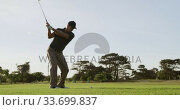 Купить «Golf player hitting the ball with his club», видеоролик № 33699837, снято 4 ноября 2019 г. (c) Wavebreak Media / Фотобанк Лори