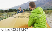 Caucasian couple taking a picture in nature. Стоковое видео, агентство Wavebreak Media / Фотобанк Лори