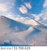 Winter field under blue sky. Nature background. Стоковое фото, фотограф Zoonar.com/Dmitry Kushch / age Fotostock / Фотобанк Лори