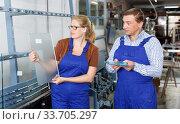 Woman and her male colleague busy working. Стоковое фото, фотограф Яков Филимонов / Фотобанк Лори