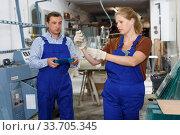 Купить «Woman and man working in glass workshop», фото № 33705345, снято 10 сентября 2018 г. (c) Яков Филимонов / Фотобанк Лори